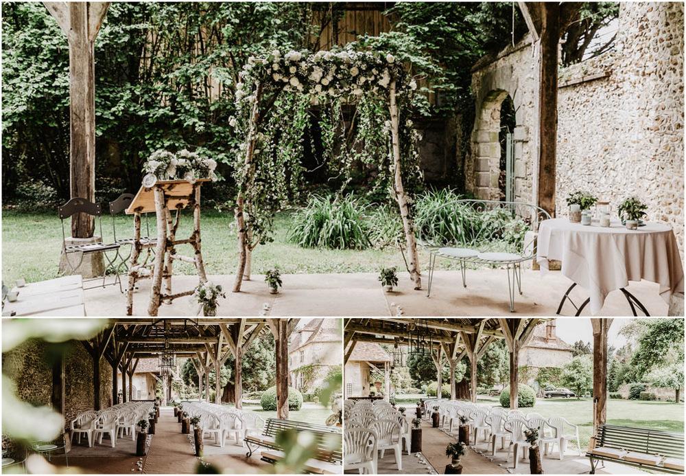 mariage champetre - manoir de vacheresses - arche de fleurs - ceremonie laique - grange - photographe eure et loir - decoration florale